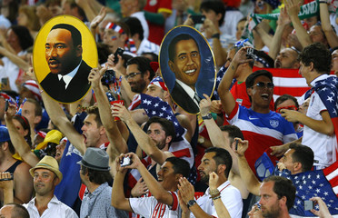 Fans of the U.S. hold up pictures of Martin Luther King Jr and U.S. President Barak Obama before the 2014 World Cup Group G soccer match between Ghana and the U.S. at the Dunas arena