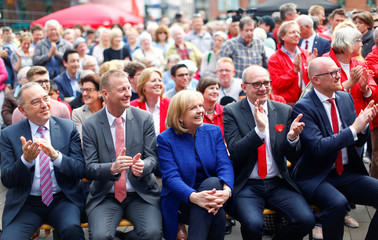 North Rhine-Westphalia State Premier and Social Democrats candidate Hannelore Kraft sits with supporters at the final election rally in Duisburg