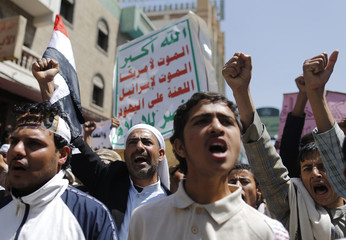 Supporters of the Shi'ite al-Houthi group shout slogans as they march during a demonstration in Yemen's capital Sanaa