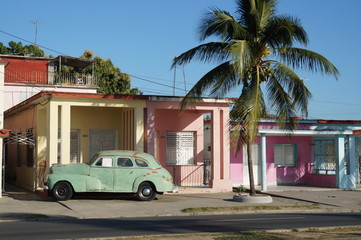 Out of time in Cienfuegos, pastel houses and old car parked