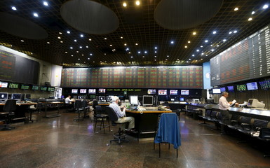 Traders work on the floor of the Buenos Aires Stock Exchange in Argentina