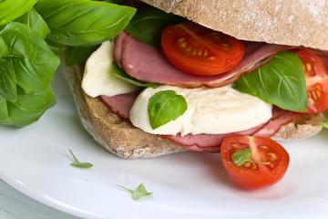 Ciabatta with ham , mozzarella, tomato and basil
