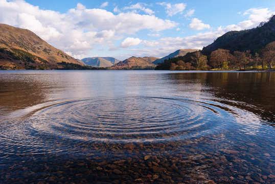 Ripples on Lake Ullswater in Cumbria. Northwest England. Also suitable as a concept of growth or expansion.