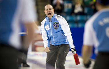 Team Quebec skip Jean-Michel Menard celebrates defeating team Alberta after their draw during the 2014 Tim Hortons Brier curling championships in Kamloops.