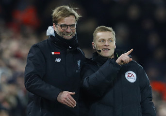 Liverpool manager Juergen Klopp with the fourth official