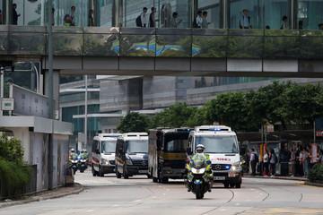 A motorcade taking British former banker Rurik Jutting to High Court in Hong Kong