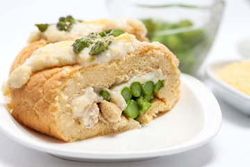 Rolled sponge cake filled with chicken and asparagus