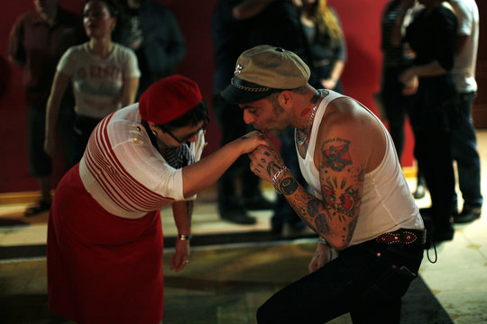 A man kisses the hand of a woman after dancing during the Rockin' Race Jamboree International Festival in Torremolinos