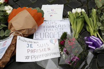 Flowers and signs placed in sympathy with the victims of the Paris attacks are seen in front of the French embassy in Rome