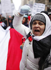 A woman shouts pro-Egypt slogans as she takes part in a rally commemorating the first anniversary of the Egyptian revolution at Times Square in New York