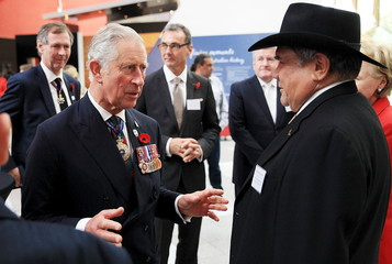 Britain's Prince Charles speaks with Aboriginal barrister and 2009 Australian of the Year Mick Dodson during a visit to the National Museum of Australia in Canberra, Australia
