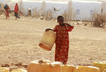 A Somali refugees girl carries an empty jerry-can as she walks to collect water at the Kobe refugee camp in Dolo Ado near the Ethiopia-Somalia border