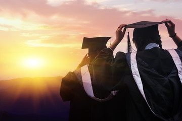 Asian college graduates wear baccalaureate suits and look to the future