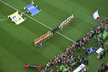 Netherlands and Argentina players stand for the anthem before the 2014 World Cup semi-finals between Argentina and the Netherlands at the Corinthians arena