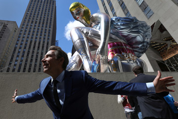 "Artist Koons poses for a portrait during the unveiling of his public art piece ""Seated Ballerina"" at Rockefeller Center in the Manhattan borough of New York City"