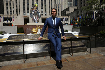 "Artist Koons poses for a photo during the unveiling of his public art piece ""Seated Ballerina"" at Rockefeller Center in the Manhattan borough of New York City"