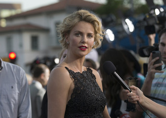 """Cast member Theron is interviewed at the premiere of """"A Million Ways to Die in the West"""" in Los Angeles"""