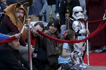 People wait before a Star Wars themed wedding in the forecourt of the TCL Chinese Theatre in Hollywood