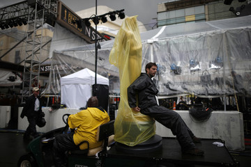 An Oscar statue is transported along Hollywood Boulevard during preparations for the 86th Academy Awards in Hollywood