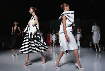 Models present creations by Australian fashion label Maticevski during a show at Australian Fashion Week in Sydney