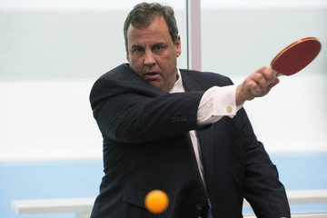 New Jersey Governor Chris Christie plays table tennis at Boys and Girls Club in Newark