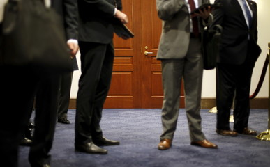 Staff members wait outside the meeting room where Sidney Blumenthal was being deposed in private session of the House Select Committee on Benghazi at the U.S. Capitol in Washington