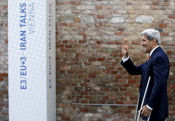 U.S. Secretary of State Kerry talks to journalists in front of Palais Coburg, the venue for nuclear talks, in Vienna.