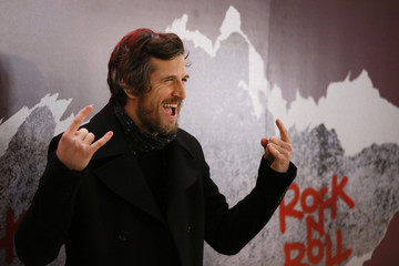 """Actor Guillaume Canet poses at a premiere of the film """"Rock'n Roll"""" in Paris"""
