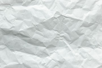 Old sheet of paper folded and battered, with paper texture.
