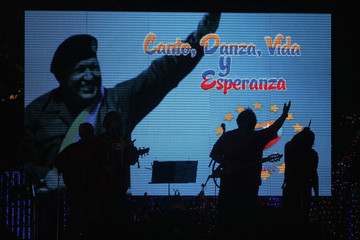 A band is silhouetted as they perform at Revolution Square, during a concert for the health of Venezuela's President Chavez, in Managua