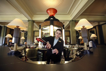 Vanessa Alfano poses for a photograph mixing a drink in the main bar of the Gleneagles Hotel, Perthshire, Scotland