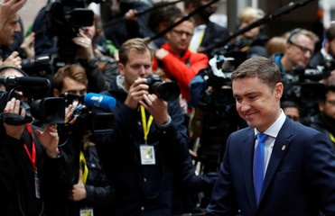Estonian Prime Minister Taavi Roivas arrives on the second day of the EU Summit in Brussels