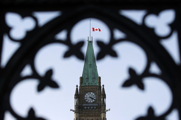The flag on the Peace Tower is lowered following news of former Finance Minister Flaherty's death on Parliament Hill in Ottawa