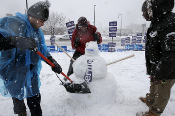 Workers build a snow man of Democratic presidential candidate Bernie Sanders in Manchester