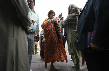 Eva Luise Koehler, wife of German President Horst Koehler, wears a robe as she arrives for a visit at the Jama Masjid in the old quarters of Delhi