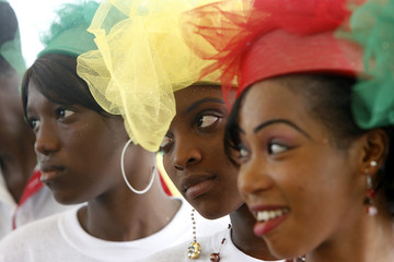 Guinean women with headscarves bearing the country's flag colours attend a meeting with the Head of Guinea's transitional government General Sekouba Konate, at the culture palace of Abidjan