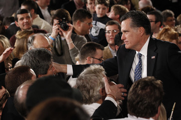 Republican U.S. presidential candidate Romney shakes hands at his South Carolina primary election night rally in Columbia