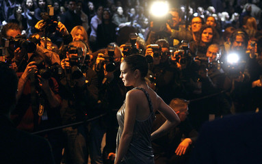 U.S. actress Lindsay Lohan poses for photographers before attending the Roberto Cavalli Fall/Winter 2010/11 Women's collection show during Milan Fashion Week