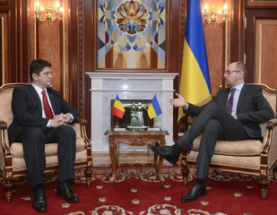 Ukraine's Prime Minister Arseny Yatseniuk meets with Romania's Minister of Foreign Affairs Titus Corlatean in Kiev