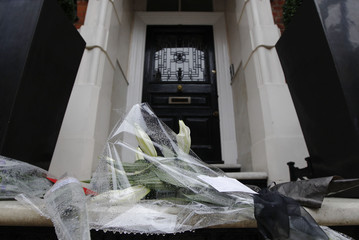 Flowers from fashion designer Louise Goldin are left on the doorstep of British fashion designer Alexander McQueen the day after he was found dead in his home in London