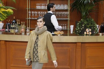 A model presents a creation by German designer Lagerfeld as part of his Autumn/Winter 2015/2016 women's ready-to-wear collection for French fashion house Chanel during Paris Fashion Week