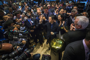 Alibaba founder Jack Ma holds up the gravel after ringing a ceremonial bell at the NYSE to celebrate the company's IPO in New York
