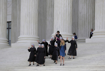 Nuns with Little Sisters of the Poor wave after Zubik v. Burwell was heard by the U.S. Supreme Court in Washington