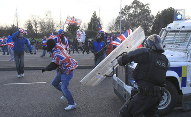 Loyalists demonstrators clash with police during rioting in East Belfast,