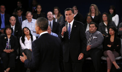 U.S. President Barack Obama and Republican presidential nominee Mitt Romney interact during the second U.S. presidential debate in Hempstead