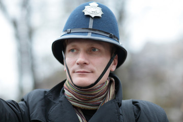 Serious man in british police hat