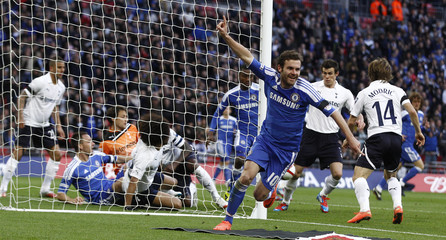 Chelsea's Mata celebrates after scoring during their FA Cup semi-final soccer match against Tottenham Hotspur at Wembley Stadium in London