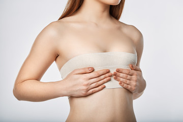 Woman breast with bandage surgery