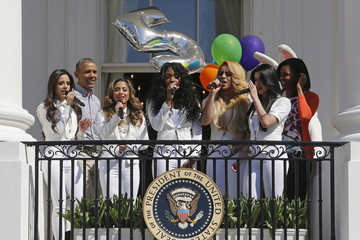 """U.S. President Barack Obama and Michelle Obama sing with Fifth Harmony to mark the anniversary of """"Let's Move!"""" children health initiative during the annual Easter Egg Roll at the White House in Washington"""