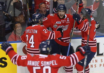 Oshawa Generals Michael Dal Colle celebrates his goal over Rimouski Oceanic with teammates during first period Memorial Cup hockey action in Quebec City